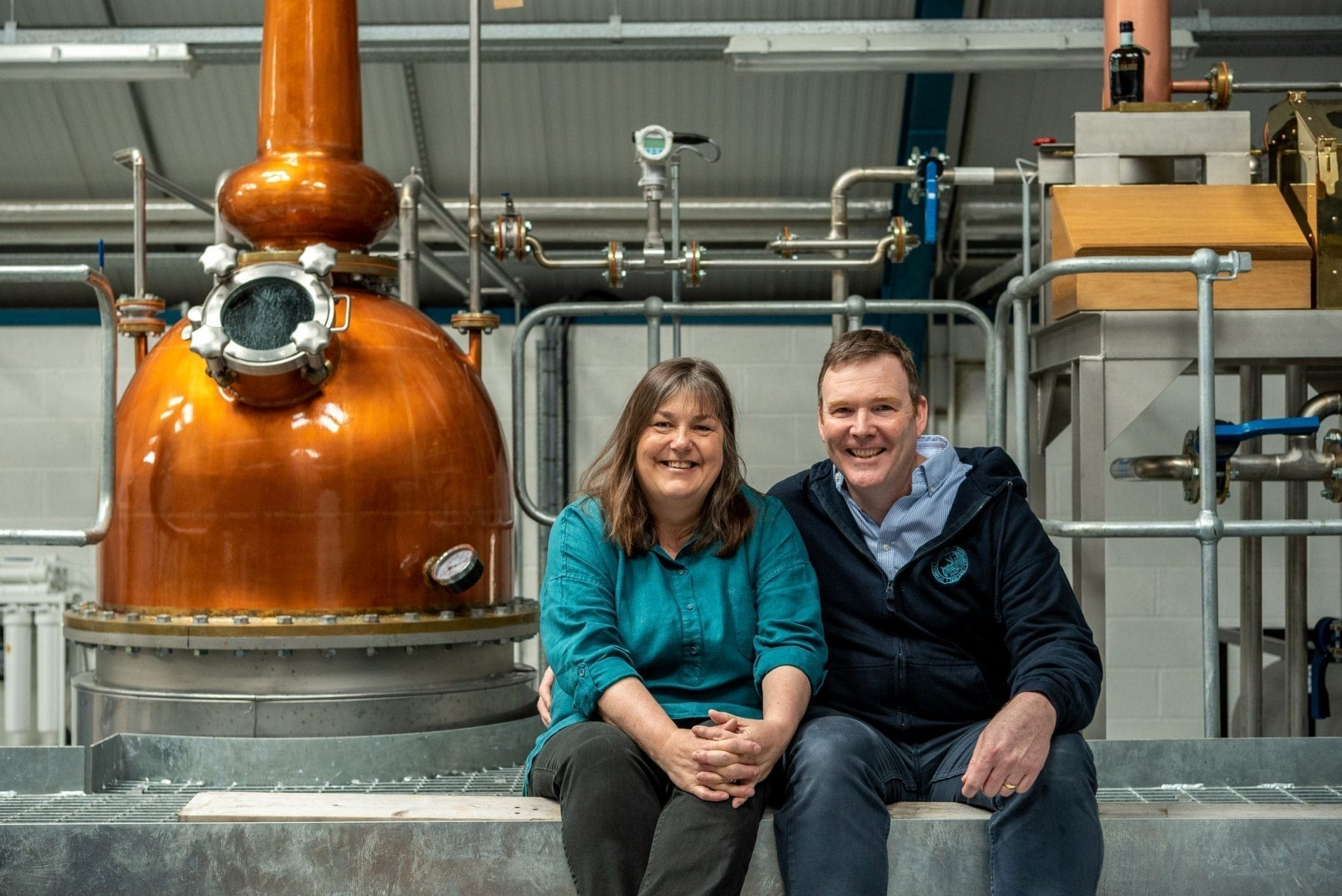"Moira and James Doherty of Sliabh Liag Distillery with Pot Still ""Méabh""."